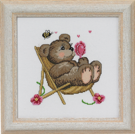 Teddy in chair